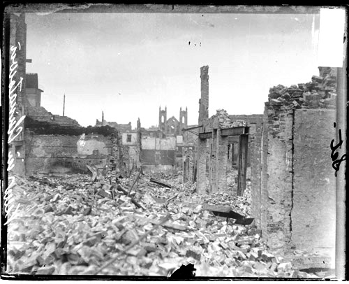 Chintatown after the earthquake. A few brick walls are standing and the ground is covered in rubble.