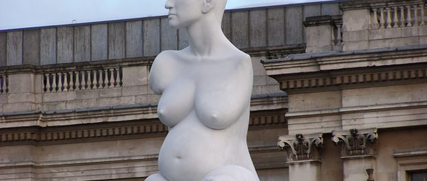 A statute of Allison Lapper in Trafalgar Square. The nude statue depicts the famous disability rights activist during her pregnancy.