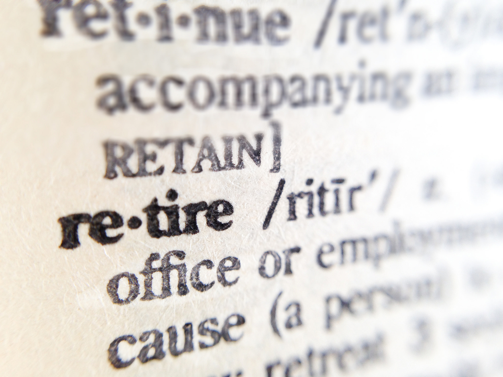 A Dictionary Open To The Definition Of RETIRE