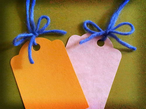 Two blank tags like those used on antiques, clothes, and similar items.