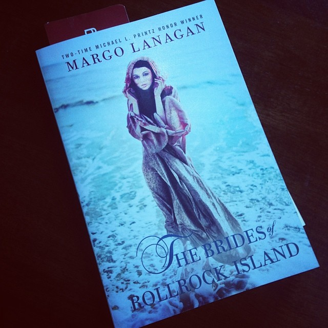 A copy of the Brides of Rollrock Island -- the cover features a young woman rising out of the sea.