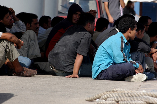 People wait to be processed at Lampedusa in Italy.