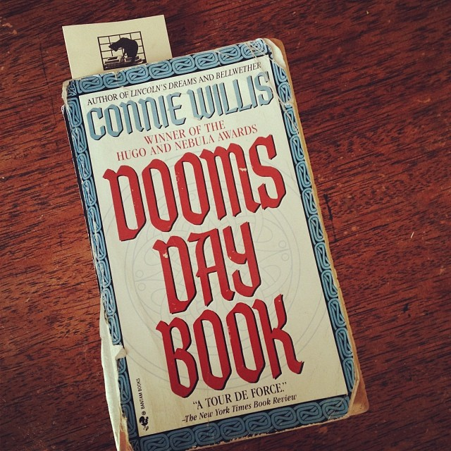 A worn paperback copy of THE DOOMSDAY BOOK.