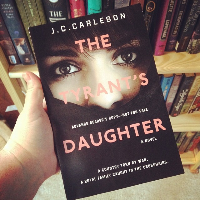 Me holding up a copy of THE TYRANT'S DAUGHTER by J.C. Carleson