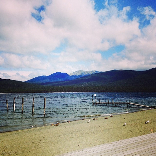Lake Te Anau in the morning, with mountains in the distance.