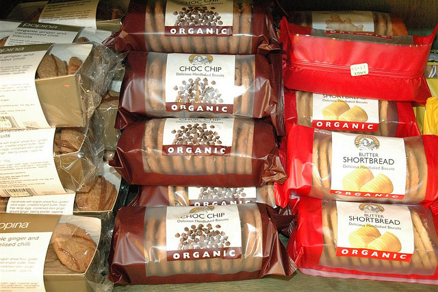 An array of organic biscuits in a grocery store.