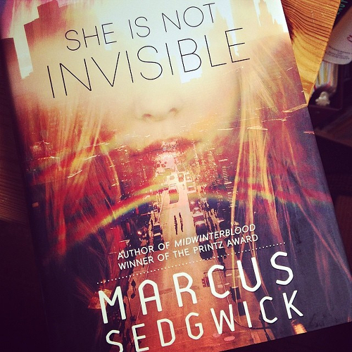 My copy of SHE IS NOT INVISIBLE on the table.