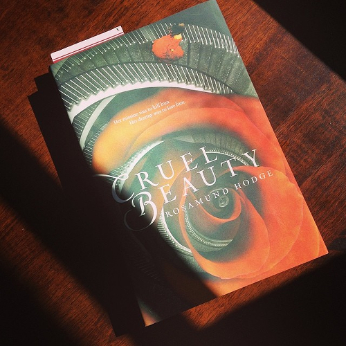 My copy of CRUEL BEAUTY, lying on the kitchen table.
