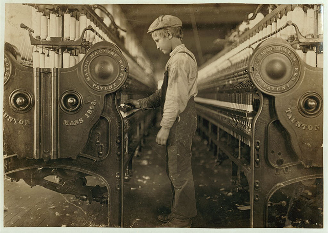 A historical photo of a child working in a mill.