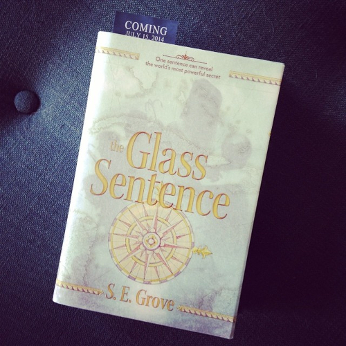 My copy of THE GLASS SENTENCE, lying on the ottoman.