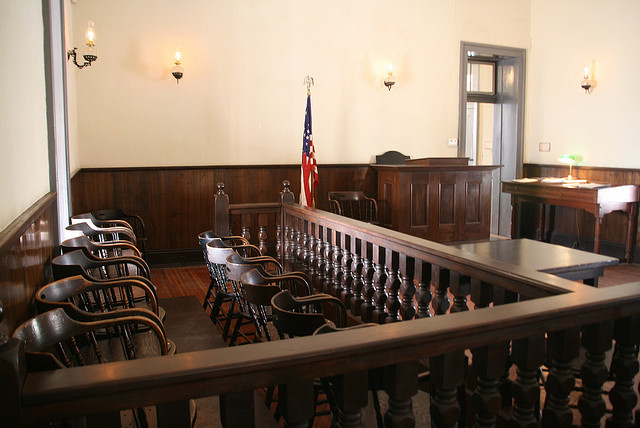 A jury box in an empty court room.