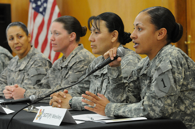 A panel of four military women at a conference on women in combat.