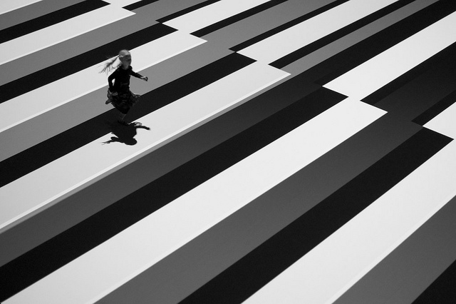 A little girl runs across a black and white test pattern.