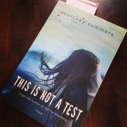 My copy of THIS IS NOT A TEST sitting on the table.