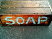 A wooden box, labeled SOAP.