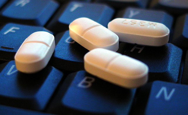 Pills scattered across a keyboard.