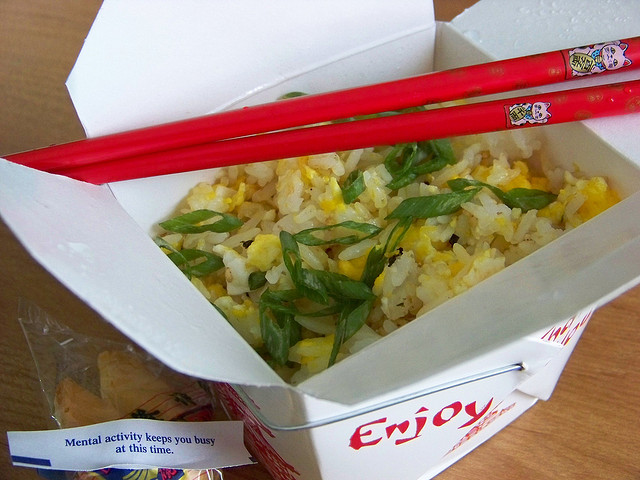 Fried rice in a takeout box that's adorned with classic chop suey font