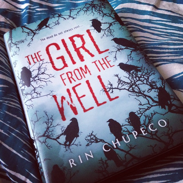 My copy of The Girl from the Well, lying on the bed.