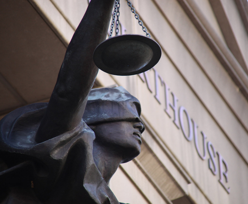 A statute of Justice outside a courthouse.