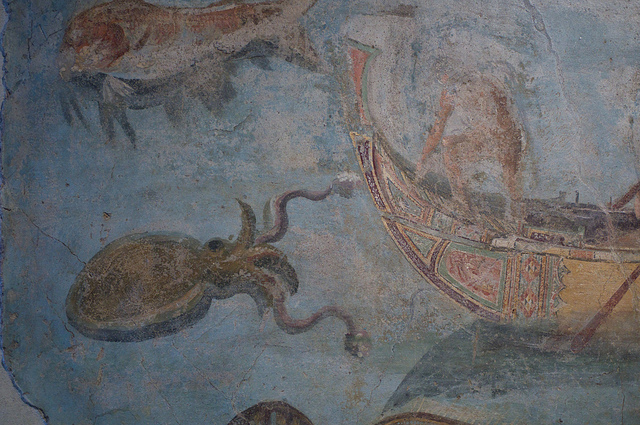 An ancient fresco of a person battling a giant squid.