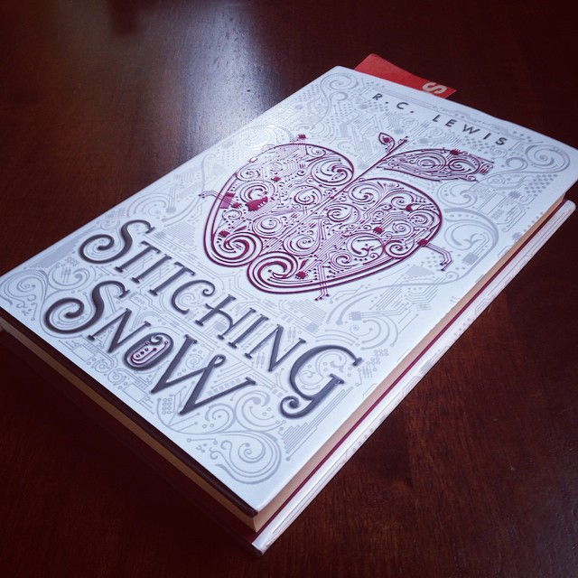 My copy of STITCHING SNOW by R.C. Lewis