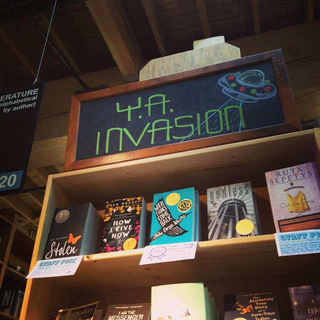 A sign at Powell's Books advertising the YA Takeover, with bestselling YA beneath