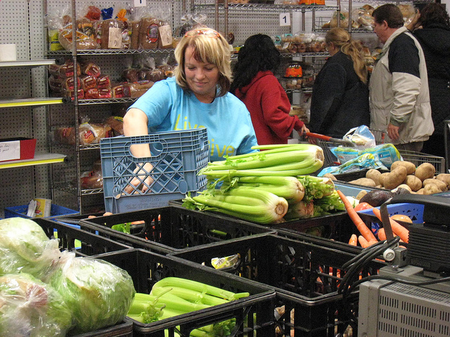 A person sorting vegetables at a food bank