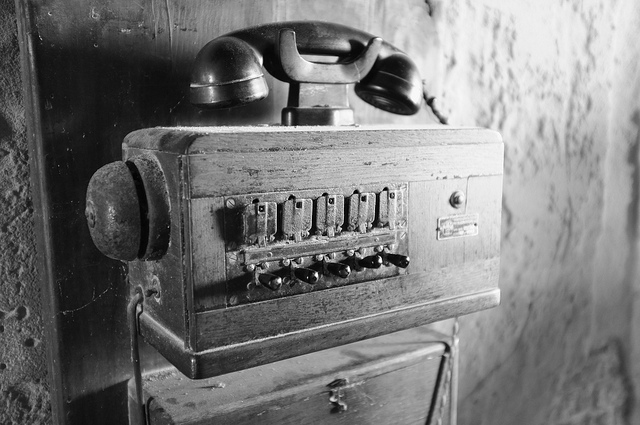 A black and white photo of an old phone