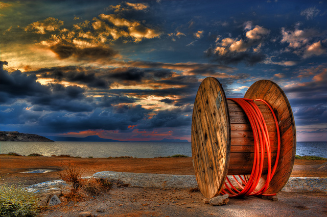 An abandoned cable reel on a seashore