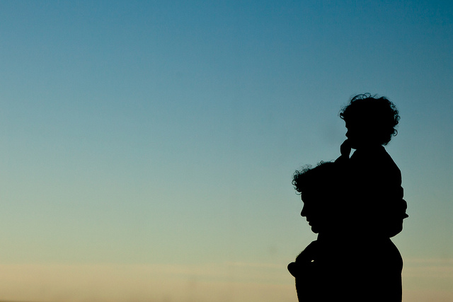 A man and his son at sunset.