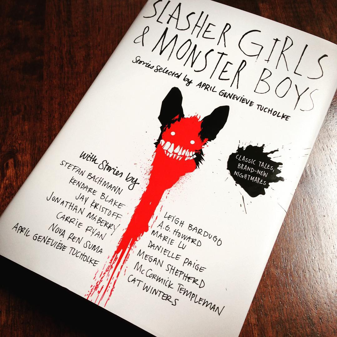 The cover of SLASHER GIRLS AND MONSTER BOYS featuring a grimacing monster and a smear of blood