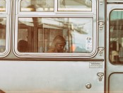 A person sitting on a bus
