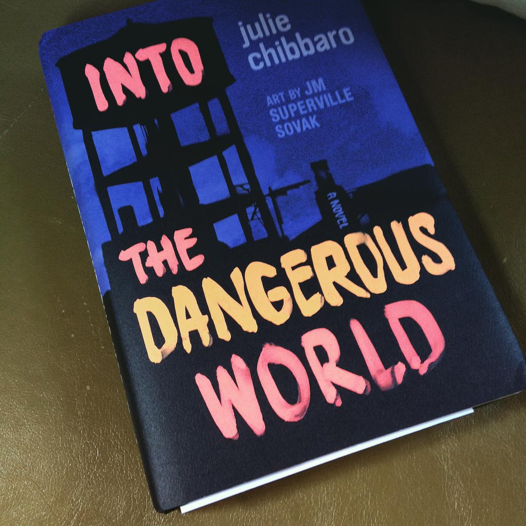A watertower on the cover of Into the Dangerous World