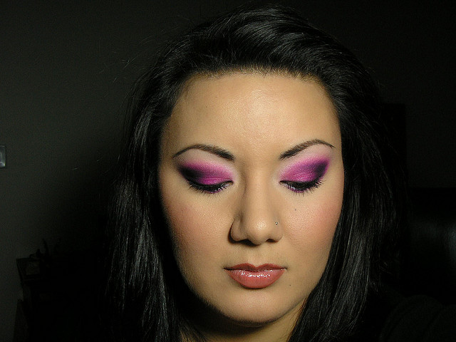 A person wearing elaborate eye makeup