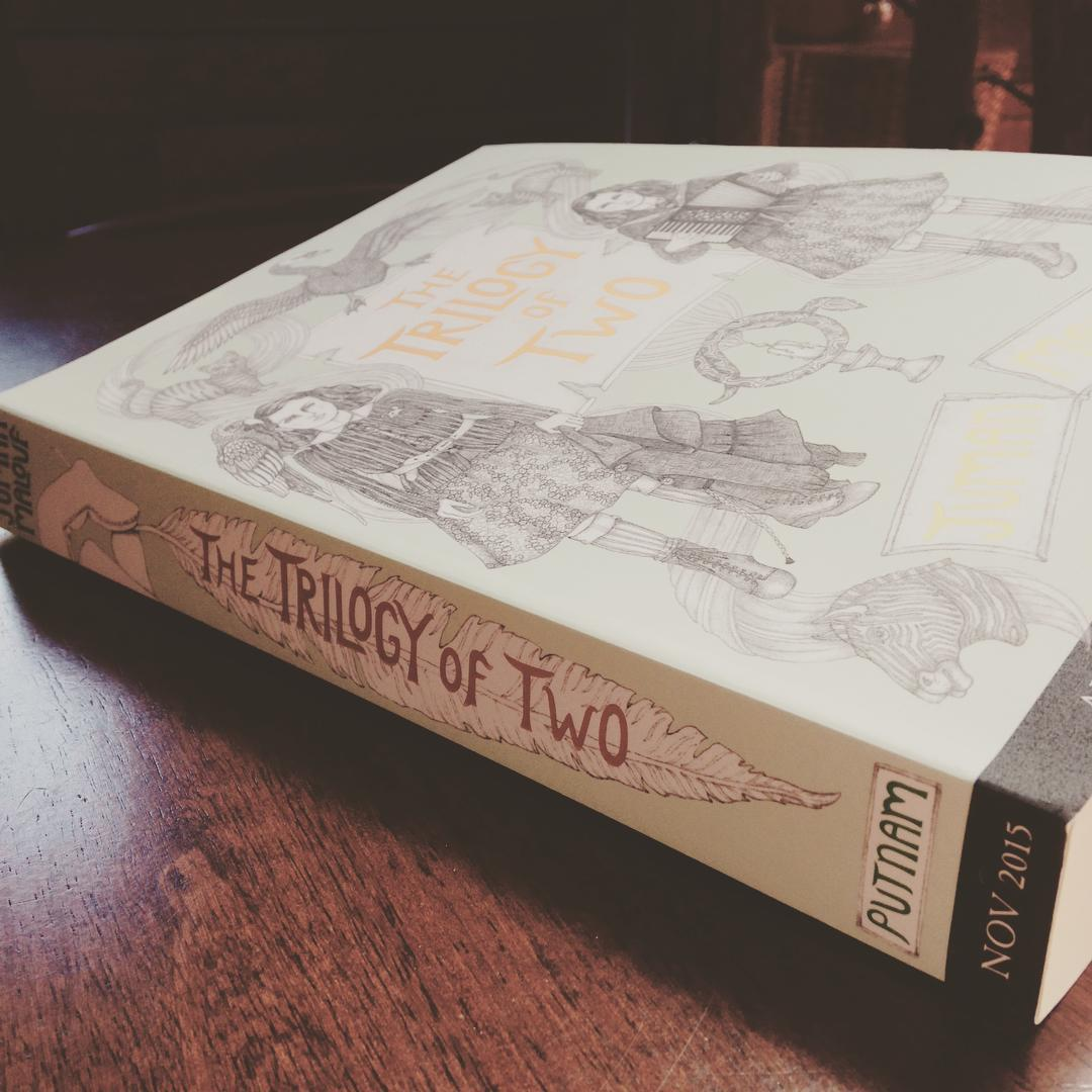 Fanciful illustrations on the cover of THE TRILOGY OF TWO.