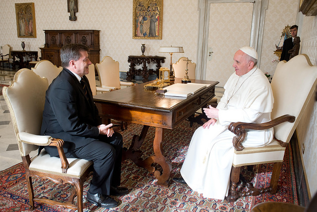 The leader of the ILO in conference with Pope Francis in a lavish office.