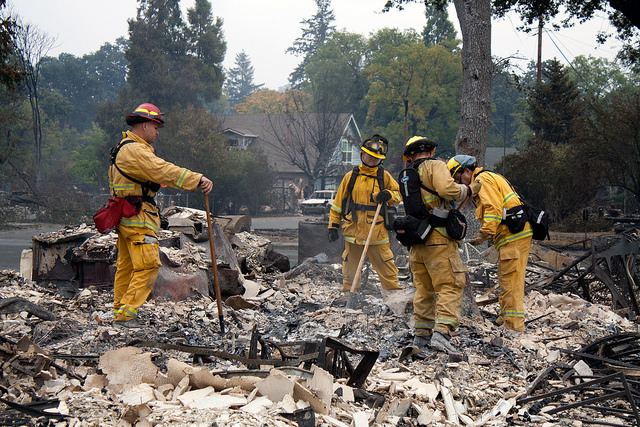 Firefighters combing through ashes in Middleton, California.