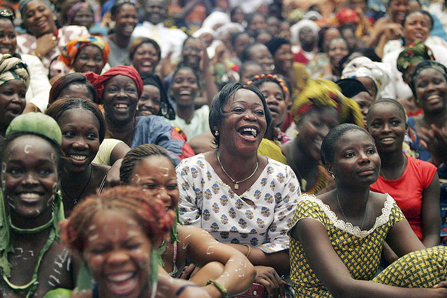A crowd of laughing and smiling African women.