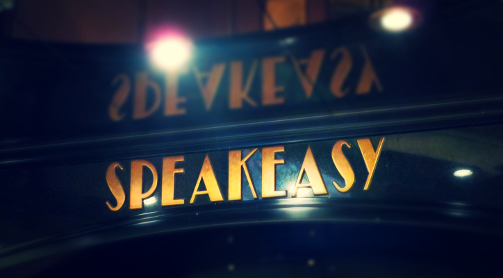 A sign advertising a speakeasy.