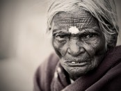An elderly woman with a bindi
