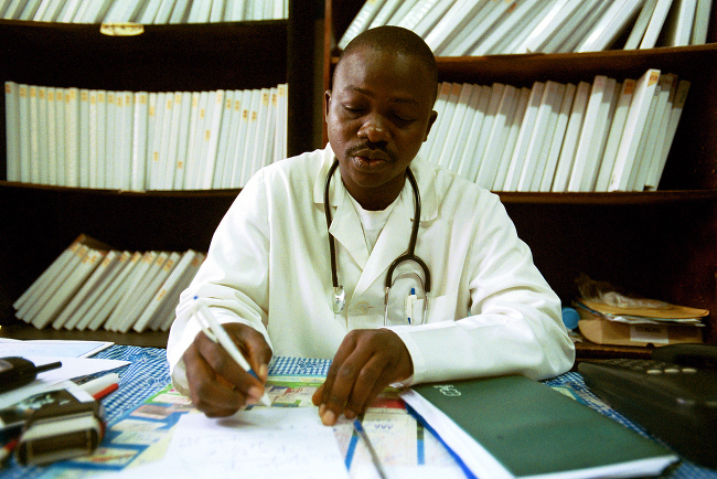 A doctor reviews a patient's record, providing medical advice.