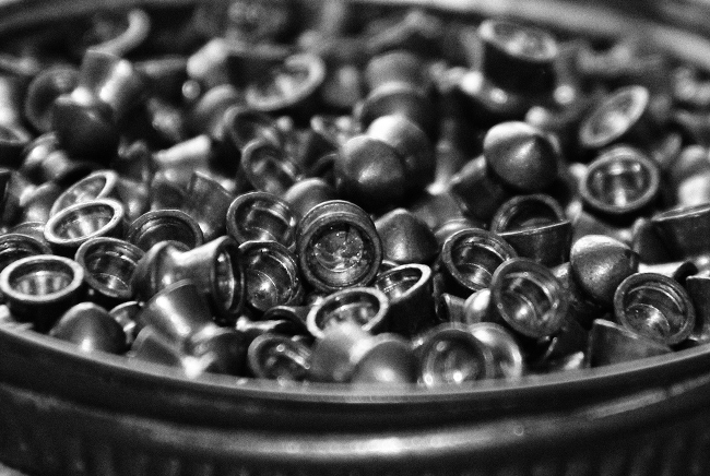 A container filled with pieces of lead.