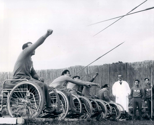 Wheelchair athletes throwing javelins.