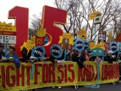 Workers rallying at a minimum wage protest
