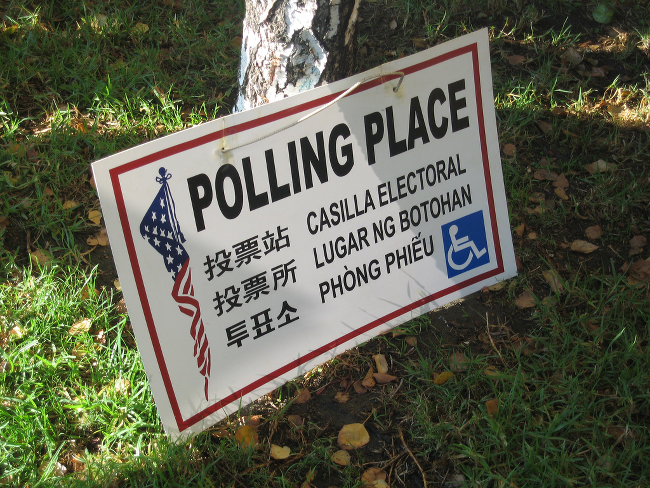 A sign for a polling place, in multiple languages.