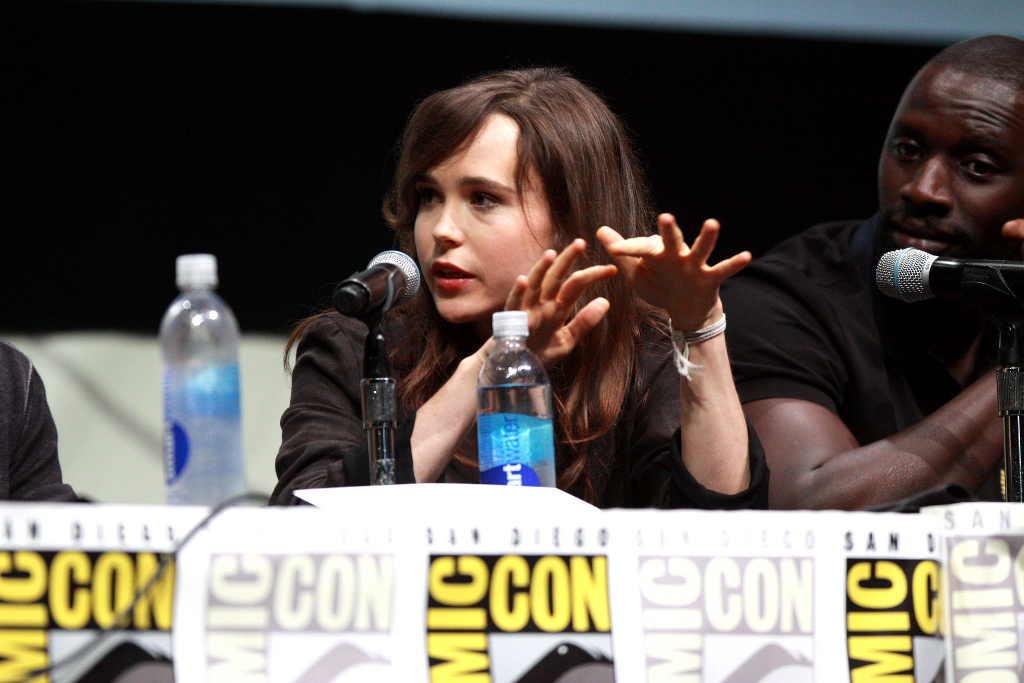 Ellen page and Omar Sy at a ComicCon panel.