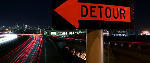 A road sign advising the observer that there is a detour ahead.