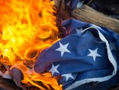 A US flag being burned in a retirement ceremony.