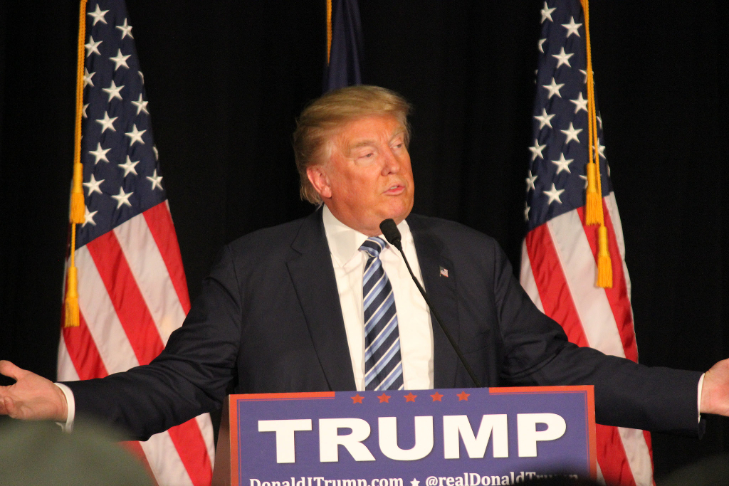 Donald Trump speaking at an event.