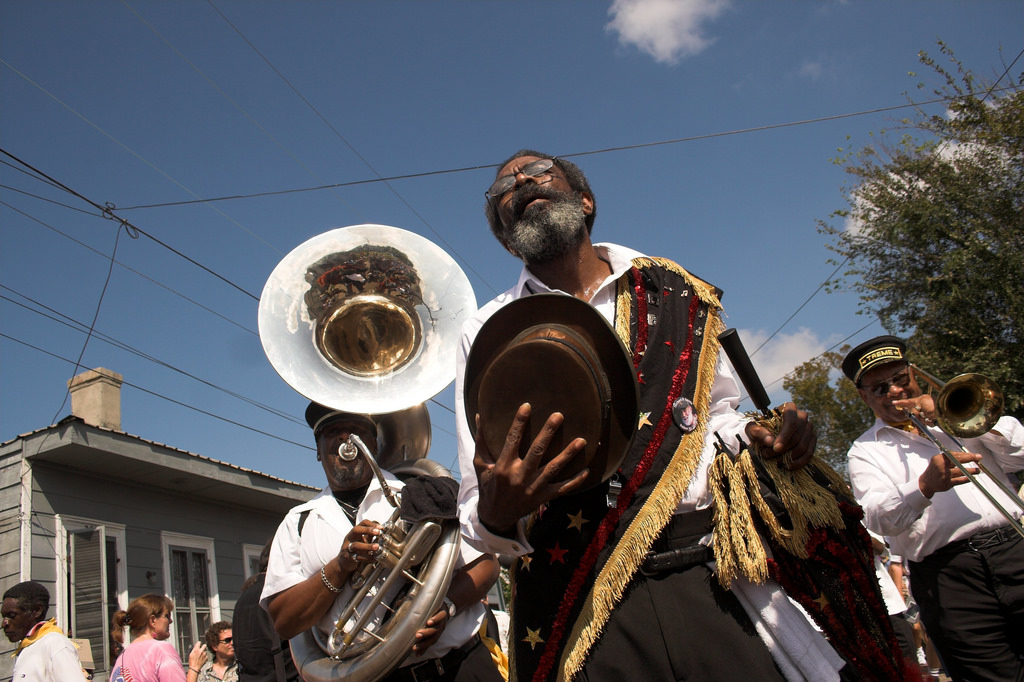 Musicians on the street at a jazz funeral.